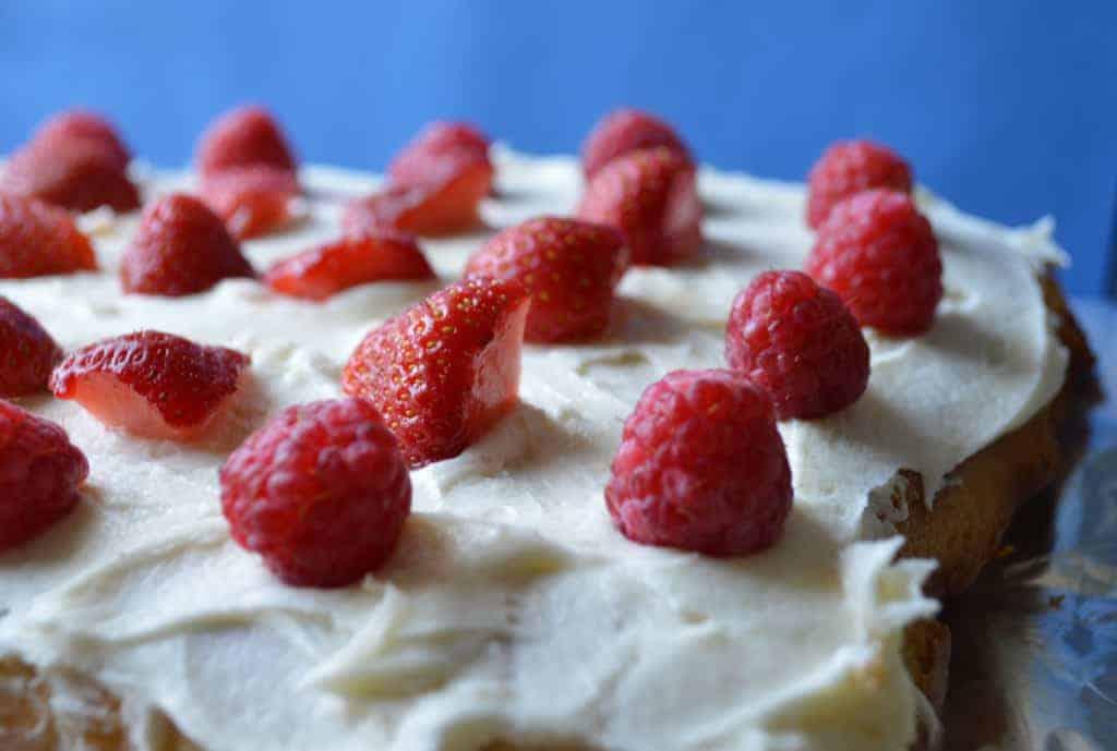 Raspberries and Strawberries on a cake